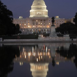 The U.S. Capitol in Washington is illuminated as the debt-limit stalemate continues Saturday night, July 30, 2011.
