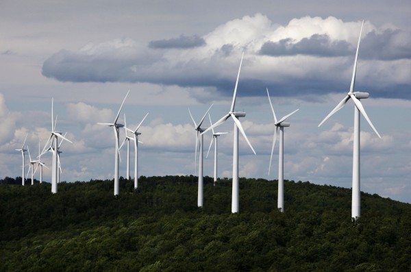 In this July 14, 2009 file photo, a cluster of windmills catch the wind blowing on Stetson Mountain, in Range 8, Township 3, Maine. Windpower was voted one of Maine's top stories of the decade.