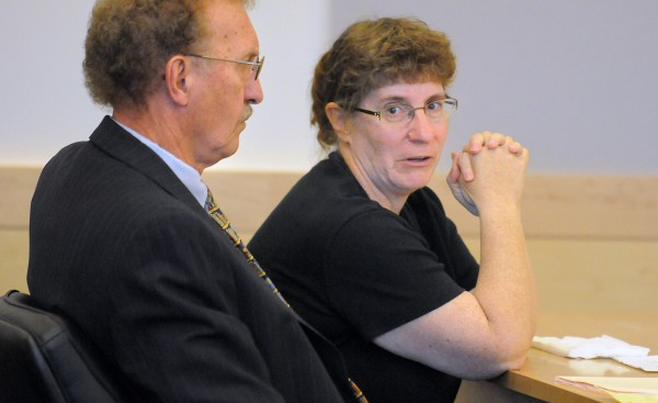 Cindy Dunton of Newburgh (right) sits in the courtroom with her attorney Dale Thistle during her sentencing at the Penobscot Judicial Center in Bangor on Friday July 1, 2011. Dunton received a five-year sentence with all but 20 months suspended for embezzling nearly $200,000 from the Town of Newburgh.