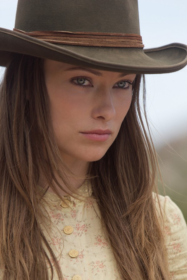 "Olivia Wilde as the elusive traveler Ella in ""Cowboys & Aliens."""