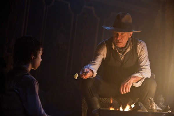 "Noah Ringer (left) as Emmett Taggart and Harrison Ford as the iron-fisted Colonel Dolarhyde in ""Cowboys & Aliens."""