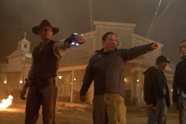 "Daniel Craig as a stranger with no memory of his past and director-executive producer Jon Favreau on the set of ""Cowboys & Aliens."""