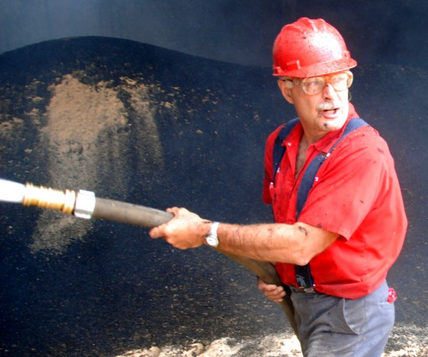 Electrician Michael Rioux douses hot spots in an attached