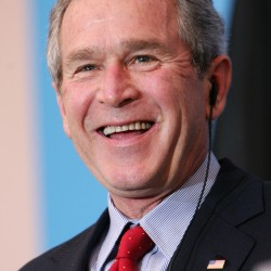 George Bush is content to stay clear of politics