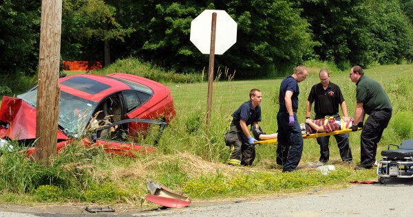 First responders put Micah Bouchard, 32, of Bangor on a gurney after he was taken out of his damaged vehicle.