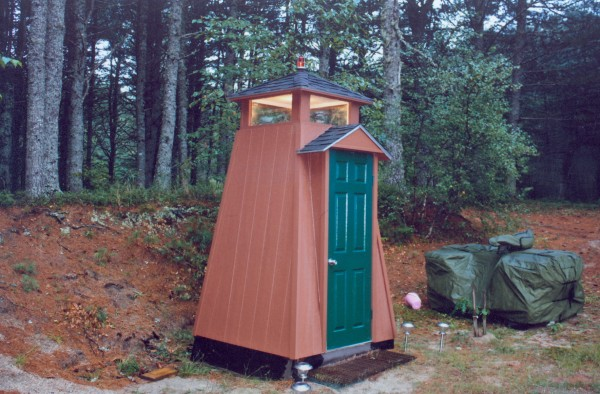 Bruce and Gothrow of Bangor, created this lighthouse themed outhouse a few years ago at their camp at Brandy Pond in Hancock County. He built it to surprise his wife Linda on her return from a trip to Florida. Linda, as you can tell from the photos is a fan of lighthouses. There is a lighthouse on the toilet seat cover, on the back wall and on the door, which also has a fire alarm. A carpeted throne and vinyl flooring complete the interior. The red light atop the structure and the lighthouse lamp below are solar powered, as are the lights lining the walkway to the facility.