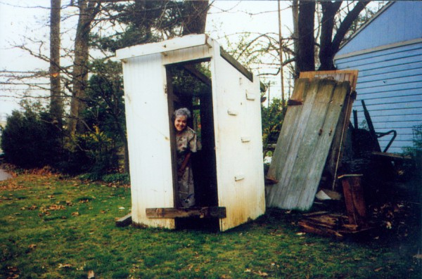 """My husband is a collector of outhouses (he has 5). Of our two favorites, we chose this one to enter. FDR instituted the WPA (Work Progress Adm.) in 1935. Outhouses were built and offered to the public for $5. If you didn't have the $5, you could get one for free. When he went to look at this one being demolished, he thought it was really in bad shape, but after longer assessment, realized it was a WPA, so he decided that was pretty special and we brought it home. He not only refurbished the outhouse to original, but located a manikan, reconfigured it to a sitting position, so now our outhouse is occupied by """"Poopin Pete"""" as our 4-year-old grandson calls him. We have many visitors come to view our outhouses."""