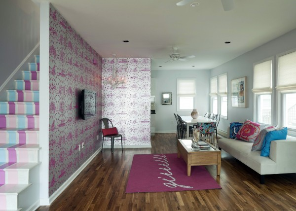 "This undated photo courtesy of HGTV shows a room designed by Cortney and Robert Novogratz, from HGTV's ""Home by Novogratz,"" at a home in Rockaway Beach, New York. Striped staircases and lavendar walls? Many homeowners are trying out the bold, unexpected use of color that high-profile designers have been preaching."