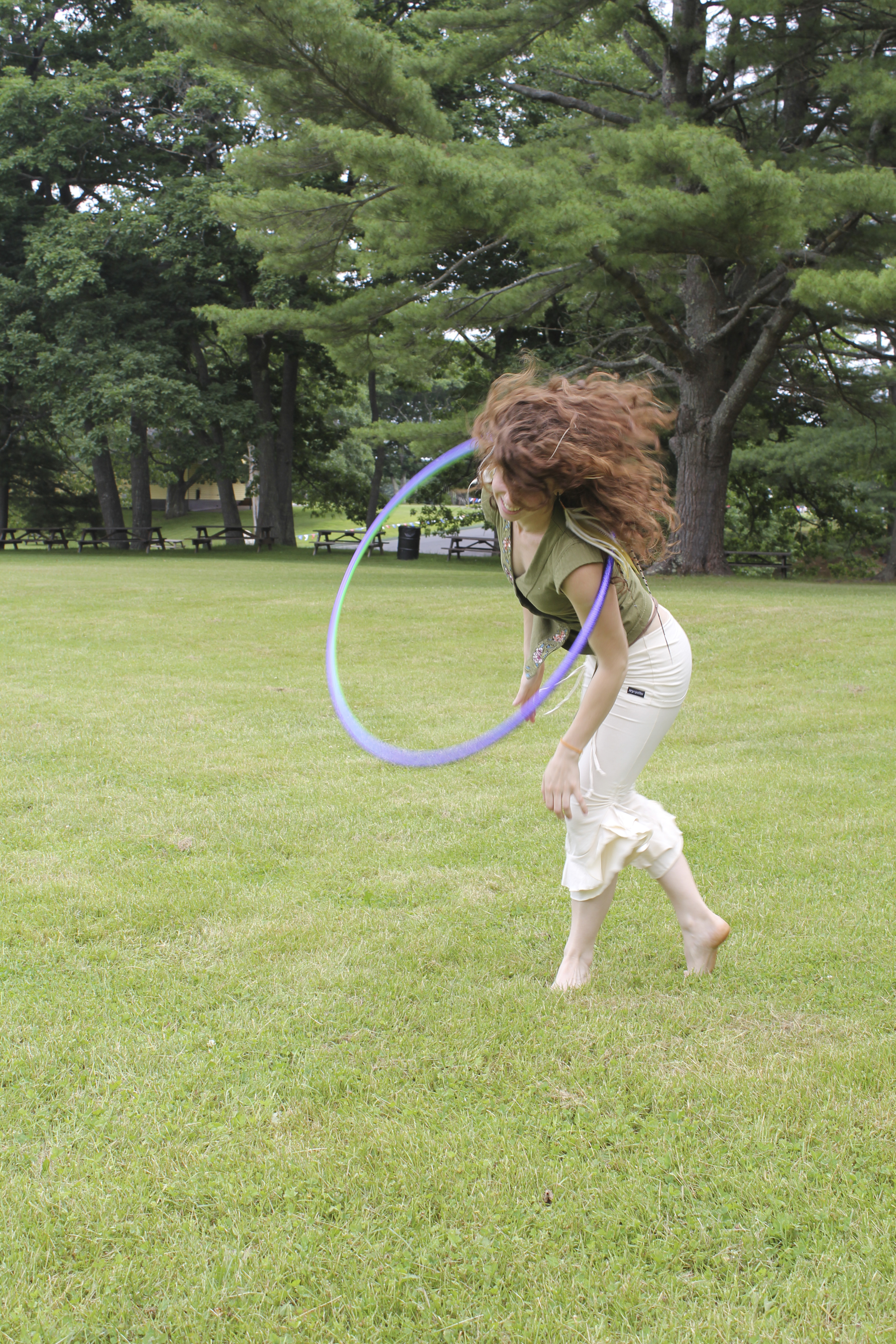 Professional hooper Lolli Hoops, 28, of Boston, twirled her hula hoop around her Friday during HoopFest New England, where she is leading workshops. The festival is the first of its kind in the nation, spurred by a national trend of hooping for fun and exercise.