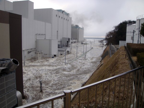 In this March 11, 2011 photo released by Tokyo Electric Power Co., the access road at the compound of the Fukushima Dai-ichi nuclear power plant is flooded as a tsunami strikes the facility following a massive earthquake in Okuma town, Fukushima Prefecture, northeastern Japan.