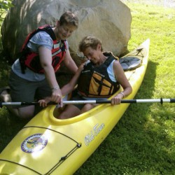 Jaye Olender, a Registered Maine Guide, explains the working parts of a kayak to a client recently. Olender specializes in leading women's trips for L.L. Bean's Outdoor Discovery School.