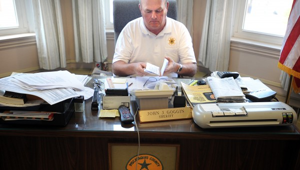 Piscataquis County Sheriff John Goggin sits in his office on Tuesday. Goggin is against the Piscataquis County commissioners' idea that sharing law enforcement duties with the Maine State Police may be an option worth considering given dwindling county finances.