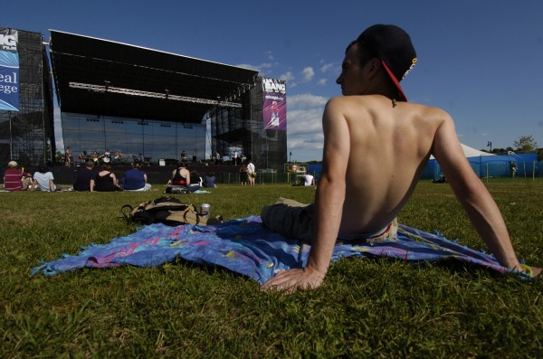 Andy Brown, 18, of Princeton takes in the scene as the Portland-based band Good Night Process performs on the Bangor Waterfront as part of the 2010 KahBang Festival lineup.