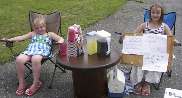 Madison Harris (left), 6, and Jessica Butler, 11, both of Caribou, took advantage of a recent summer afternoon to sell lemonade and grape-flavored Kool-Aid in an attempt to quench the thirsts of passing motorists and to raise money for Jessica's Dad, Curtis, who has been diagnosed with skin cancer.