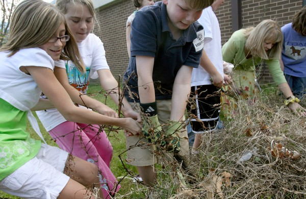 Students pull weeds out of a flowerbed at Coventry Elementary in Yorktown, Va.