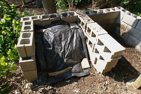 Composting piles or containers can be constructed of almost anything, including these cinder blocks at River Legacy Park in Arlington, Texas, June 11, 2011.
