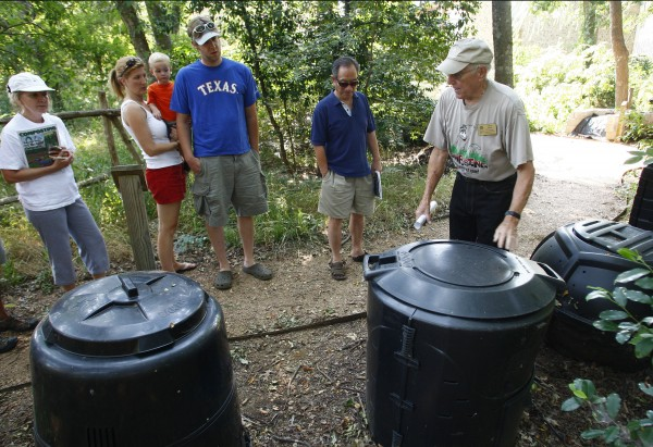 Charlie Shiner (right) describes containers that can be purchased for composting to a small group at River Legacy Park in Arlington, Texas, June 11, 2011.