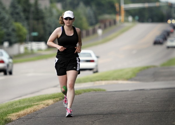 Chelseas Reynolds performs a short training run in Apple Valley, Minnesota, days before competing in the Life Time Fitness Triathlon. She had withdrawn from competitve swimming eight years ago because of foot tumors.