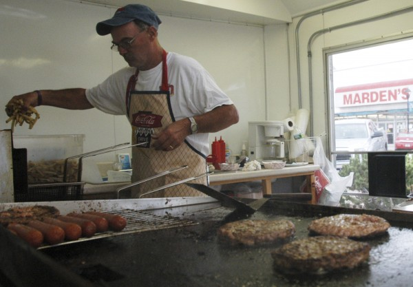 Dave Downs, 52, of Lee, throws french fries in the broiler in his Greta and Dave's Place concessions stand at the 2010 Lincoln Homecoming Festival. This year's homecoming event goes into full gear at 8 a.m. Thursday, July 21 and ends on Sunday, July 24.