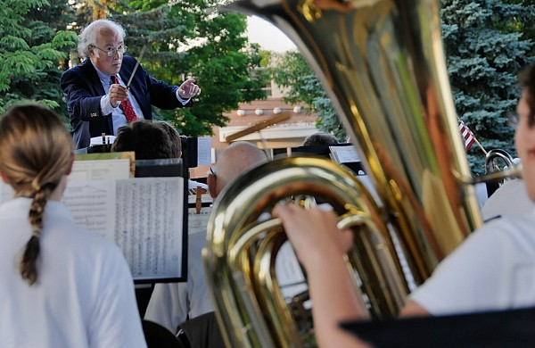 Dr. Fred Goldrich, conductor of the Bangor Band, leads the group during Monday evening's Fourth of July performance at Paul Bunyan Park. Because of the coming arena construction, the band's final concert at the park took place Tuesday evening, July 5, 2011.
