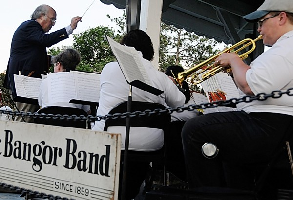 Dr. Fred Goldrich (left), conductor of the Bangor Band, leads the group during Monday evening's Fourth of July performance at Paul Bunyan Park. Because of the coming arena construction, the band's final concert at the park took place Tuesday evening, July 5, 2011.