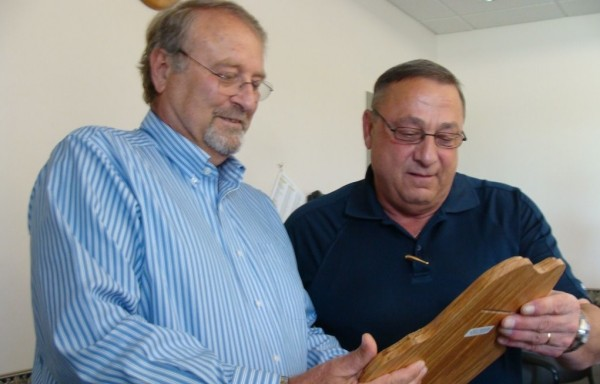 Mayo Regional Hospital CEO Ralph Gabarro and Gov. Paul LePage examine about a plaque awarded to the hospital Thursday by the State Employee Health Commission. The hospital is one of five in the state to consistently meet the criteria that the commission established for preferred hospitals. LePage was in Piscataquis County on Thursday for his Capitol of the Day program.