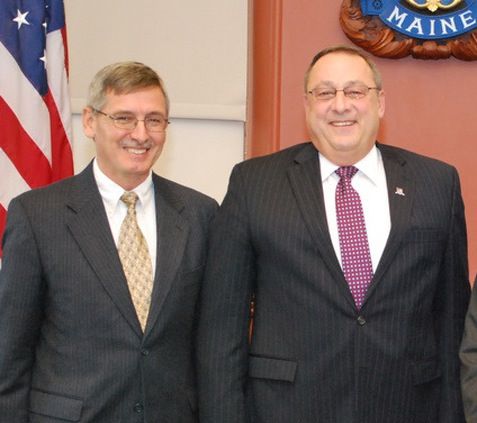 Gov. Paul LePage stands with Norman Olsen of Cherryfield, when he was nominated to lead the Department of Marine Resources. Olsen submitted his resignation Wednesday, July 20.