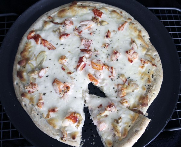 A freshly-cooked lobster pizza cools on a rack in West Bath, Maine recently.