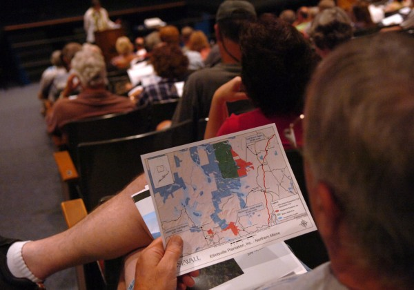 Audience members look over maps of the northern Maine region as Roxanne Quimby of Elliotsville Plantation Inc, presents &quotEconomic Benefits of National Parks on Gateway Communities&quot in Millinocket.