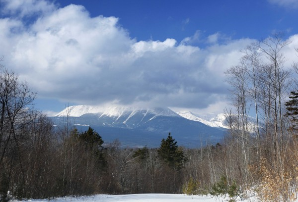 In this Jan. 28, 2011 photo, clouds hide the summit of Mount Katahdin in Baxter State Park, in this view from land owned by Roxanne Quimby in Township 3, Range 8, Maine. Quimby, the founder of Burts Bees, wants to donate 70,000 acres east of Baxter to the federal government with the aim of creating a Maine Woods National Park.