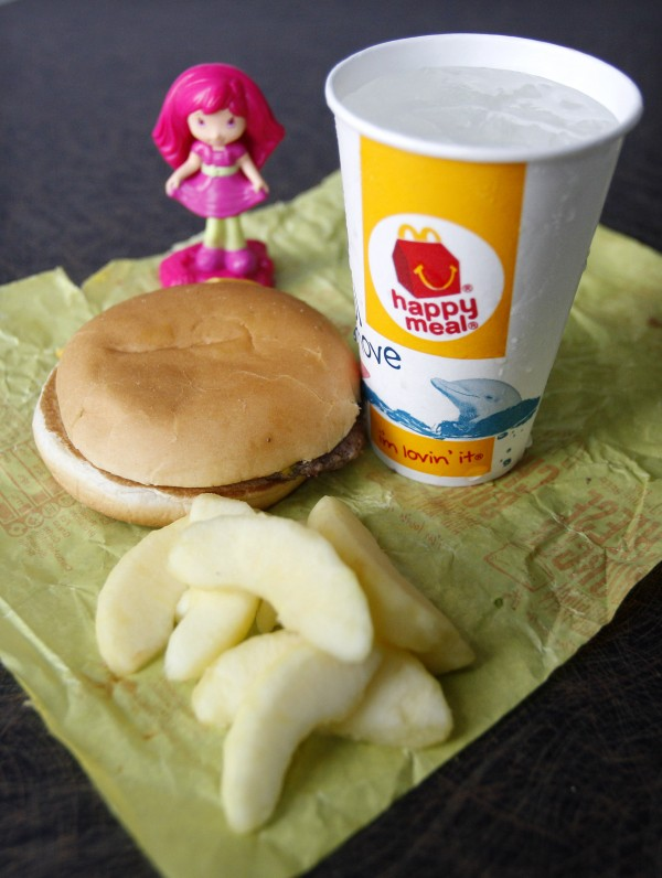 A McDonald's Cheeseburger Happy Meal with the new apple slices option is shown on Tuesday, July 26, 2011, in Pittsburgh. McDonald's Corp. says it is adding apple slices to every Happy Meal, part of the chain's larger push to paint itself as a healthyplace to eat.