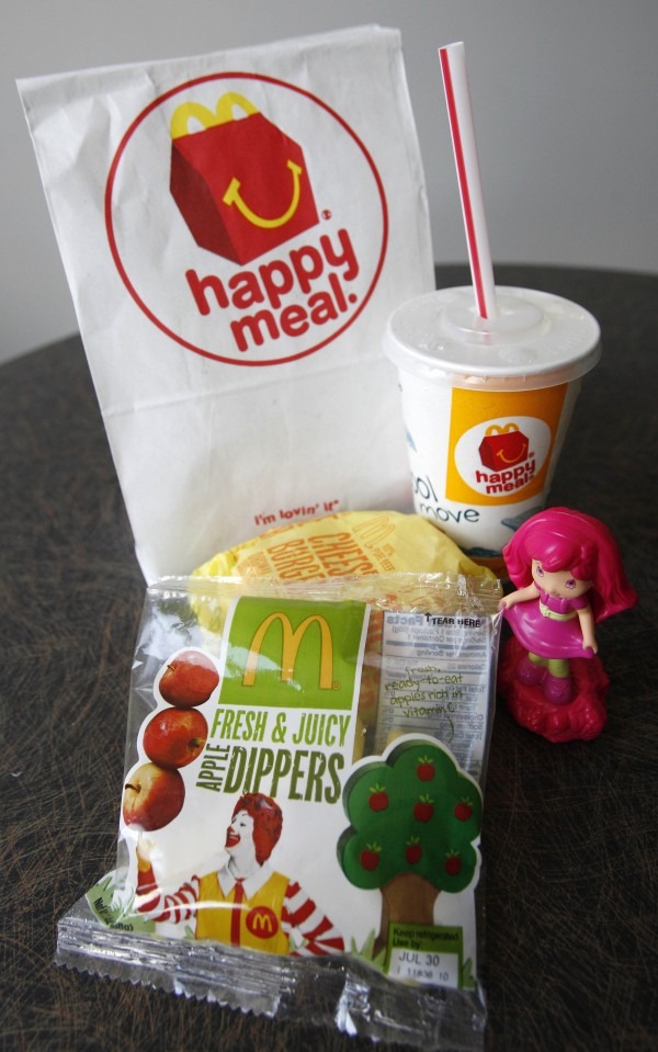A McDonald's Cheeseburger Happy Meal with the new apple slices option is shown on Tuesday, July 26, 2011 in Pittsburgh. McDonald's Corp. says it is adding apple slices to every Happy Meal, part of the chain's larger push to paint itself as a healthy place to eat.