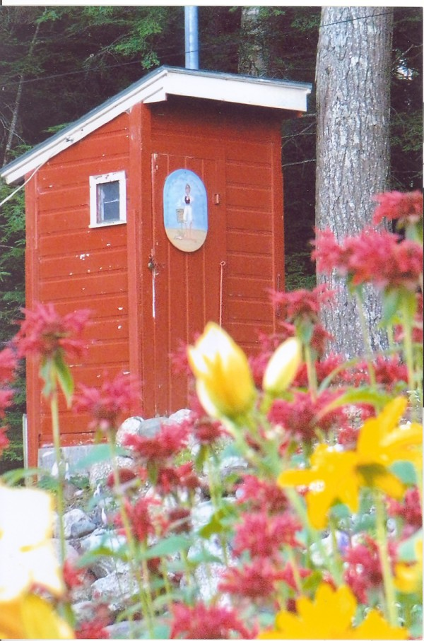 I am an outhouse located at Beech Hill Pond. I have had three owners over the years. I was born in 1950 on the West Shore Road and have had many good years. There are many attributes that make me a unique outhouse. I am able to host two users at the same time, I have electricity, I am painted and decorated, and now I have a new tiled floor. But I have not always been so impressive. During my life with my second owner, I began to deteriorate. I need a new skirt, new paint, roof work, and most of all a new floor. On the 4th of July celebrations of 2000, I was hosting two users. When they were doing their thing, my floor gave way and the larger of the two woman dropped six feet to the bottom of the outhouse. It required a ladder to get her out. Needless to say, the lady never returned to visit me and shortly after this traumatic event the camp was sold to the current owners. They have turned me around and given me a second life. I now have new paint inside and out, a new skirt, better lighting and most importantly a new floor to host my guests. With my second chance of life I feel I am one of the best outhouses out there. I have many friends on Beech Hill Pond, and I am by far the most attractive outhouse of them all.
