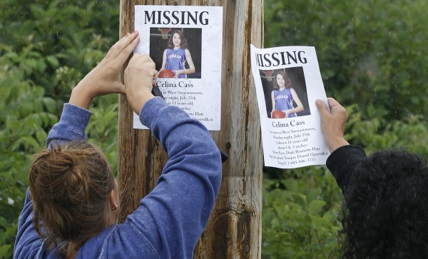 Lori McKearney, of Lancaster, N.H., right, and Kaylin Pettit, of Stewartstown, N.H., post missing posters for 11-year-old Celina Cass in Colebrook, N.H., Wednesday, July 28, 2011.  Cass has been reported missing since she was last seen at her home on Monday evening.  McKearney is Celina Cass's aunt.