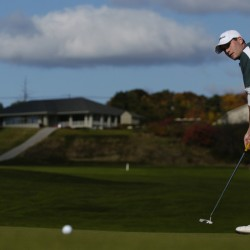 Husson University junior and co-captain Kevin Byrne putts to hole one during an October 2009 round of the North Atlantic Conference Golf Championship at Penobscot Valley Country Club in Orono.
