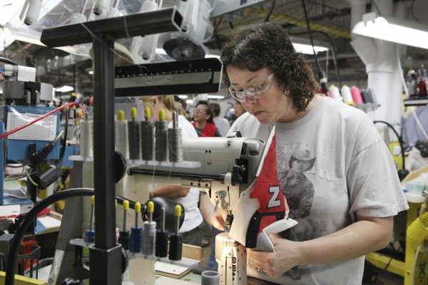 Robin MacFarland sews the upper of a New Balance 574 in Norridgewock. Despite the benefits of free trade, it can also destroy some U.S. jobs, and those losses are felt more acutely in a time of high unemployment.