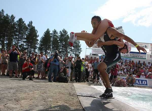 Dave and Lacey Castro of Alfred emerge from the water pit during the World Wife Carrying Championships in Sonkajarvi, Finland, earlier this month.