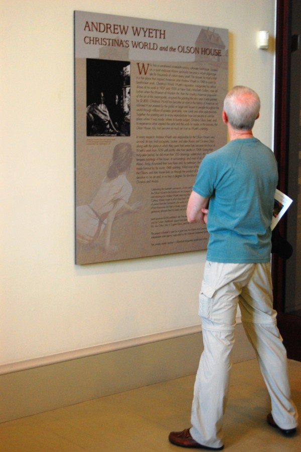 "A visitor pauses to read the plaque for the exhibit ""Andrew Wyeth, Christina's World and the Olson House"" at the Farnsworth Art Museum's Wyeth Center on Wednesday, July 27, 2011."