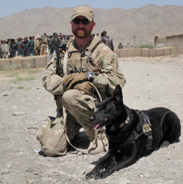 Army Staff Sgt. Robert Springmann and his dog Freida are shown at a checkpoint in Afghanistan this summer. Springmann's son Tyler was killed in Afghanistan recently.