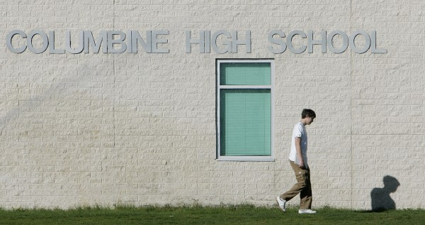 This Wednesday, April 19, 2006 file photo shows a student as he arrives for classes at Columbine High School in Littleton, Colo., on the eve of the 7th anniversary of the shooting massacre at the school. Columbine opted not to install metal detectors or turn itself into a fortress after the 1999 tragedy.