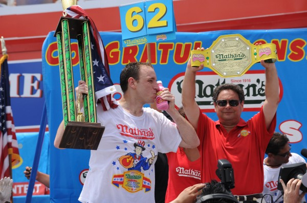 In this photograph taken by AP Images for Pepto-Bismol, champion Joey Chestnut kisses a bottle of Pepto-Bismol after eating 62 hot dogs at the Nathan's Famous Fourth of July International Hot Dog Eating Contest, Monday, July 4, 2011, in Coney Island, NY. Pepto-Bismol is the official stomach remedy of the contest.