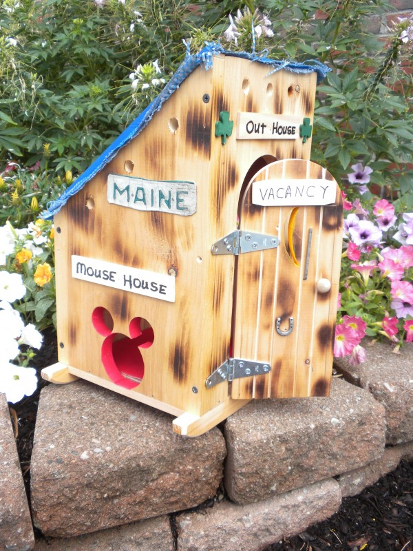 While Milford woodworker Bill Everett's entry is certainly downsized, it's not without some Maine humor with touches like the blue tarp for the roof, the Moxie sticker, the bird roost and the doggy door in the rear.