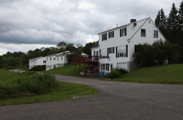 Three houses near the site of the former state prison, that were recently sold to the present warden are seen Friday, July 1, 2011 in Thomaston, Maine. Maine lawmakers will review the state's sale of property for $175,000, far below its $458,000 town-assessed value.