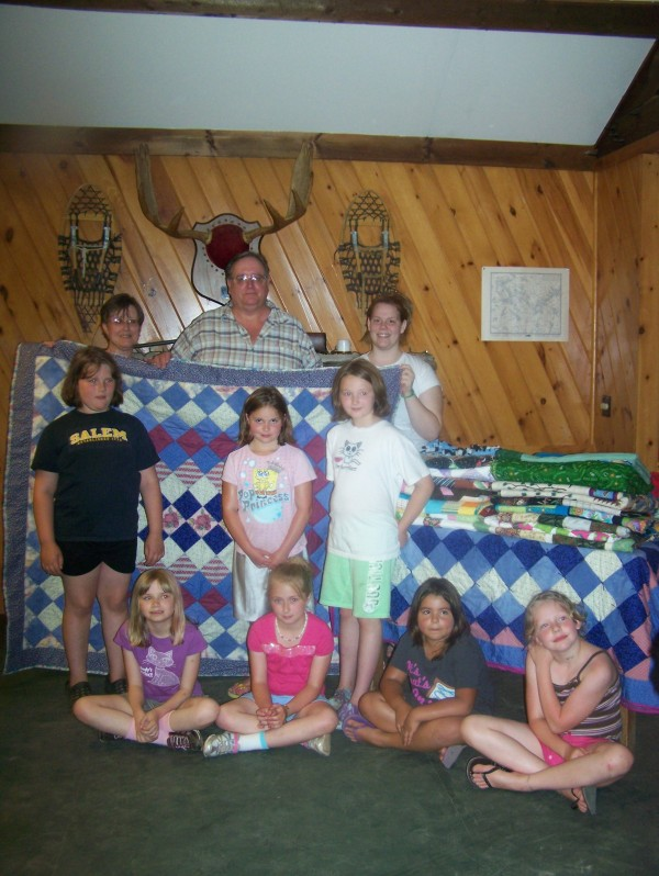 Bonnie Hunter, president of St. Croix International Quilters, delivered 25 quilts to Greenland Point Center. Pictured are (back row, left to right) Hunter, Greenland Point executive director Jon Speed and Shelby Diadone; Rita Micklus (middle row, left to right), Courtney Francis and Megan Lincoln and, Katelyn Ward (third row, left to right), Alissa Lester, Seanna Bouley-Caparotta and Emily Curtis.