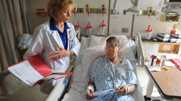 Cindy Whited, the research coordinator with Northeast Cardiology Associates, talks to Tom Christensen, who joined a clinical study with the Bangor practice. Christensen, 62, of Bangor was hospitalized at Eastern Maine Medical Center following a heart attack late last week.