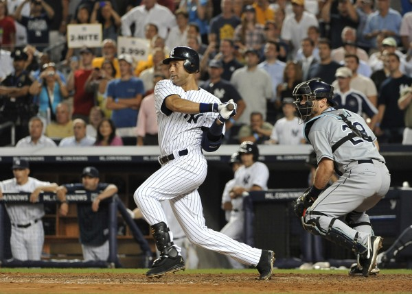 New York Yankees' Derek Jeter grounds out to shortstop in the seventh inning of a baseball game against the Tampa Bay Rays on Thursday, July 7, 2011, at Yankee Stadium in New York. John Jaso caches for the Rays.
