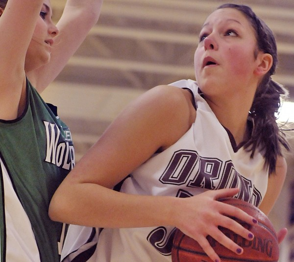 Jillian Woodward (right) of Orono looks to put up a shot against Schenck's Morgan Thompson during a high school basketball game in January 2011. Woodward, daughter of University of Maine men's basketball coach Ted Woodward, said her father provides help in her sport, answers questions and always lends support.