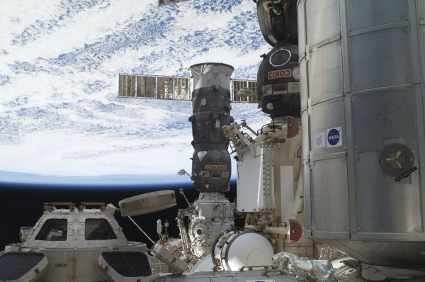 This image provided by NASA was photographed during a July 12 spacewalk, shows the International Space Station's Cupola, backdropped against black space, a horizon scene and various components of the orbiting outpost, including the Leonardo Permanent Multipurpose Module, right, along with two &quotparked&quot Russian spacecraft -- a Soyuz and a progress supply ship. Node 3 or Tranquility (on which the Cupola is mounted) is just out of frame, bottom. After getting a little free time Thursday July 13, 2011, the last space shuttle crew was woken up to deal with a second computer failure on Atlantis.