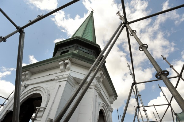 The steeple of Hammond Street Congregational Church in Bangor surrounded by scaffolding. Nickerson and O'Day is renovating part of the bell tower, fixing structural and cosmetic problems on the building that was built in 1833.