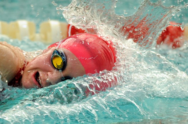 """""""Freestyle swimmer"""" is the third place photo in the Sports Action category in Class I of the 2011 New England Associated Press News Executives Association contest. In this photo, Bangor High School's Emma Waddell competes in the 200-yard freestyle during the Penobscot Valley Conference girls swimming and diving championships at the Husson University pool in Bangor in February 2011. Waddell set a PVC record with a winning time of 1 minute, 55:15 seconds to help Bangor capture the team title."""